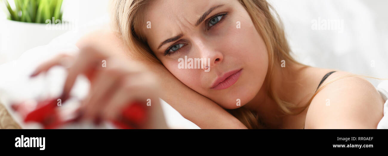young woman wake up in the morning after night party - Stock Image