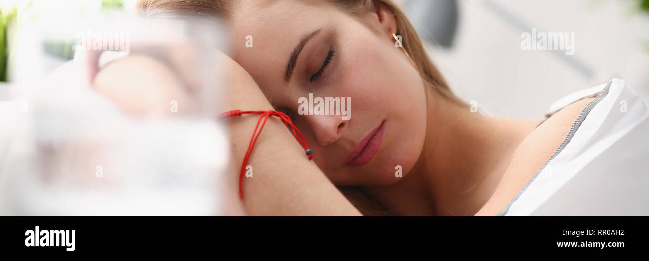 woman is ill take drugs sleep in bed - Stock Image