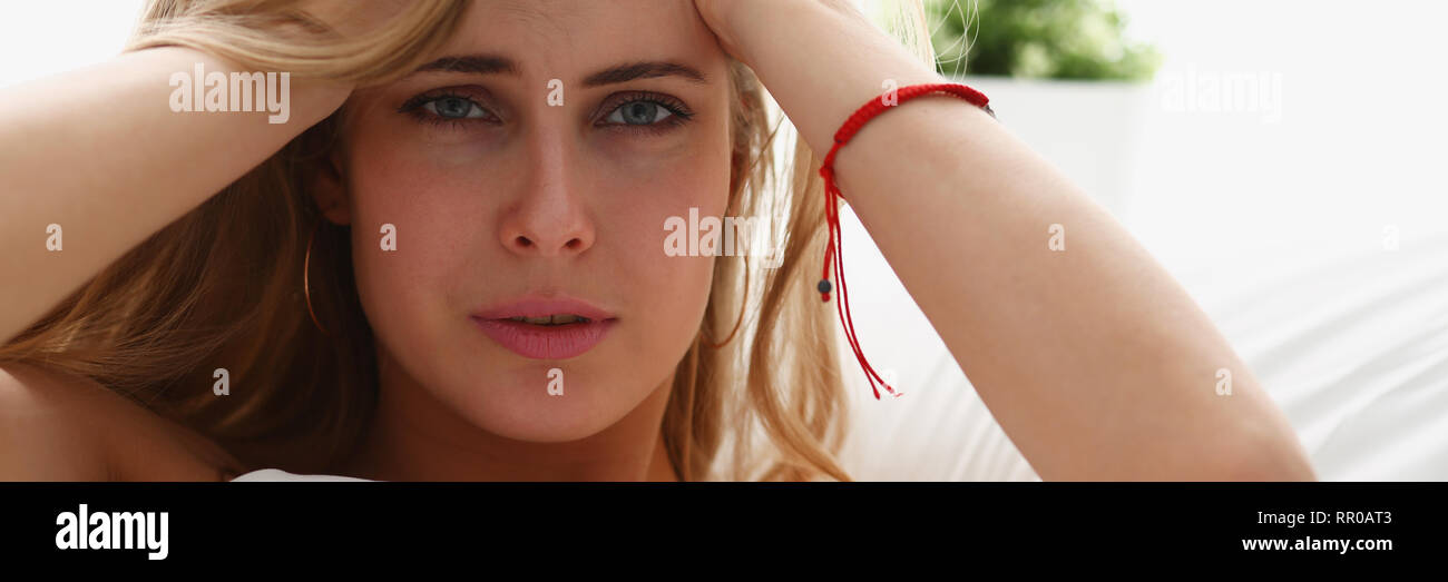 young woman is ill stay in bed have a headacke - Stock Image
