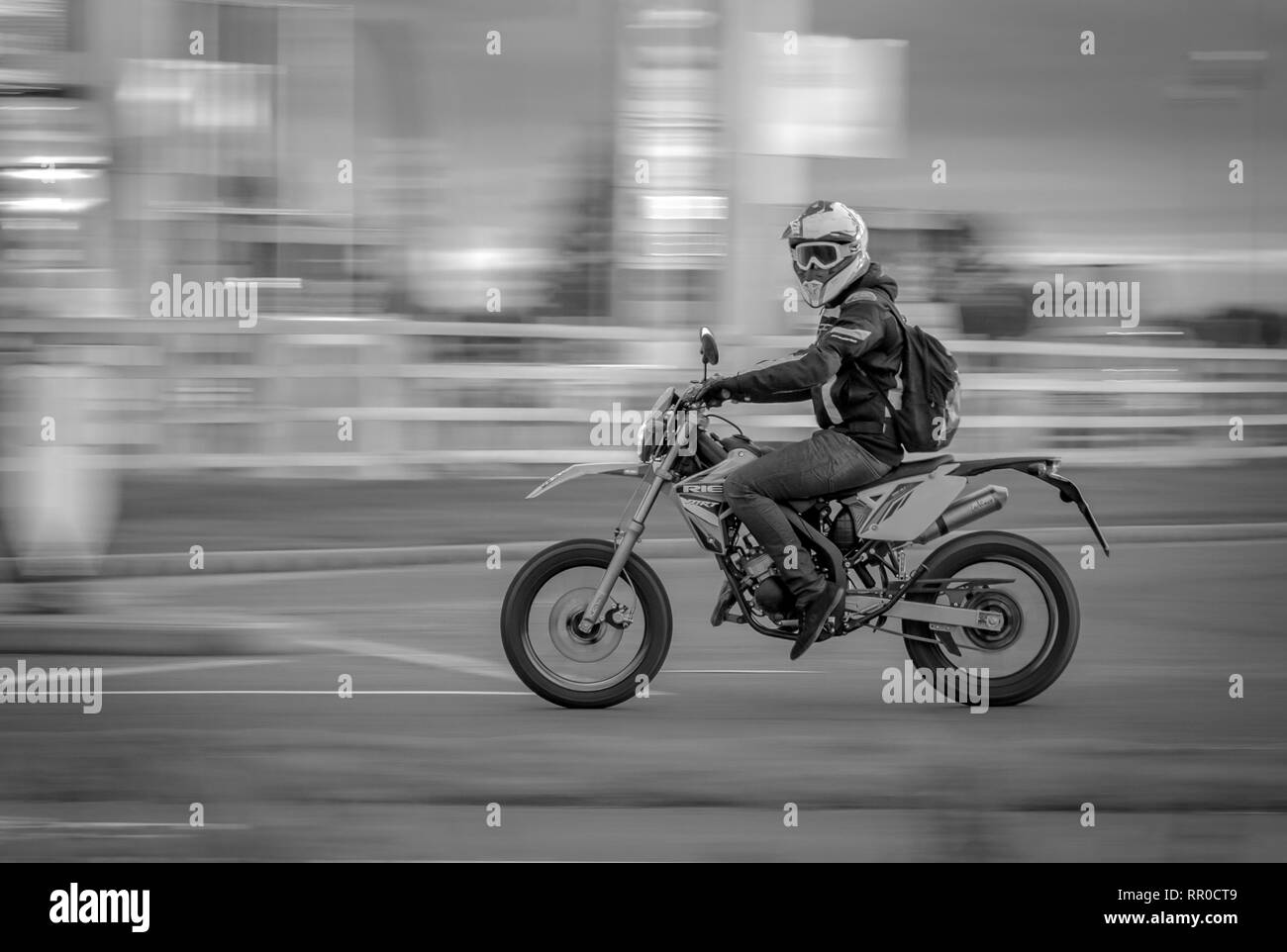 Motor bike rider with motion blur - Stock Image