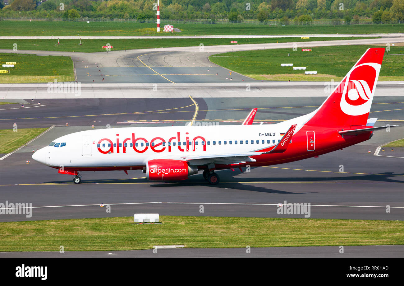 Aircraft Boeing 737-76J AirBerlin airline running on the runway of the airport before takeoff - Stock Image