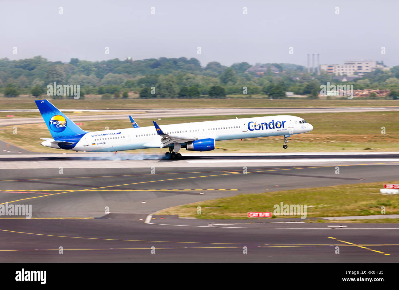 An airplane Boeing 757-300 of 'Condor' airline , part of the largest tourist brand 'Thomas cook', lands on the runway of an airport - Stock Image