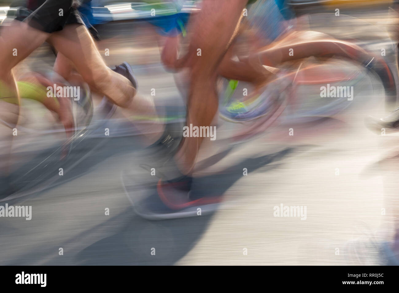 Detail of runners legs in motion - Stock Image
