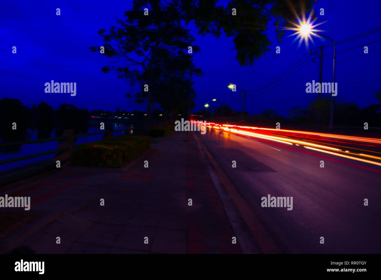 Car Lights At Night In City And Headlights Long Exposure With Copy Space Add Text Stock Photo Alamy