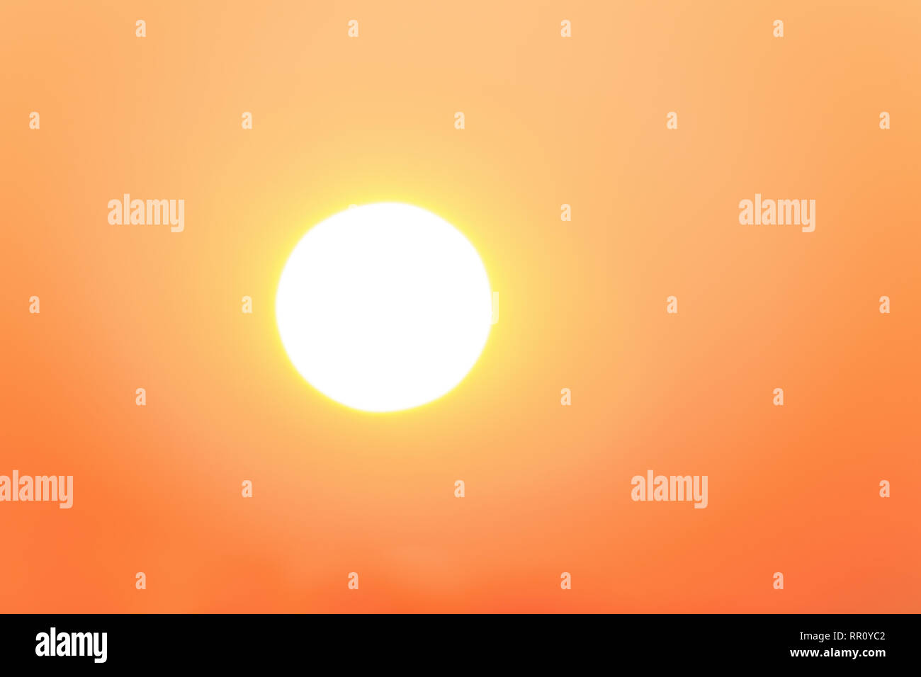 Bright sun on orange sky - Stock Image