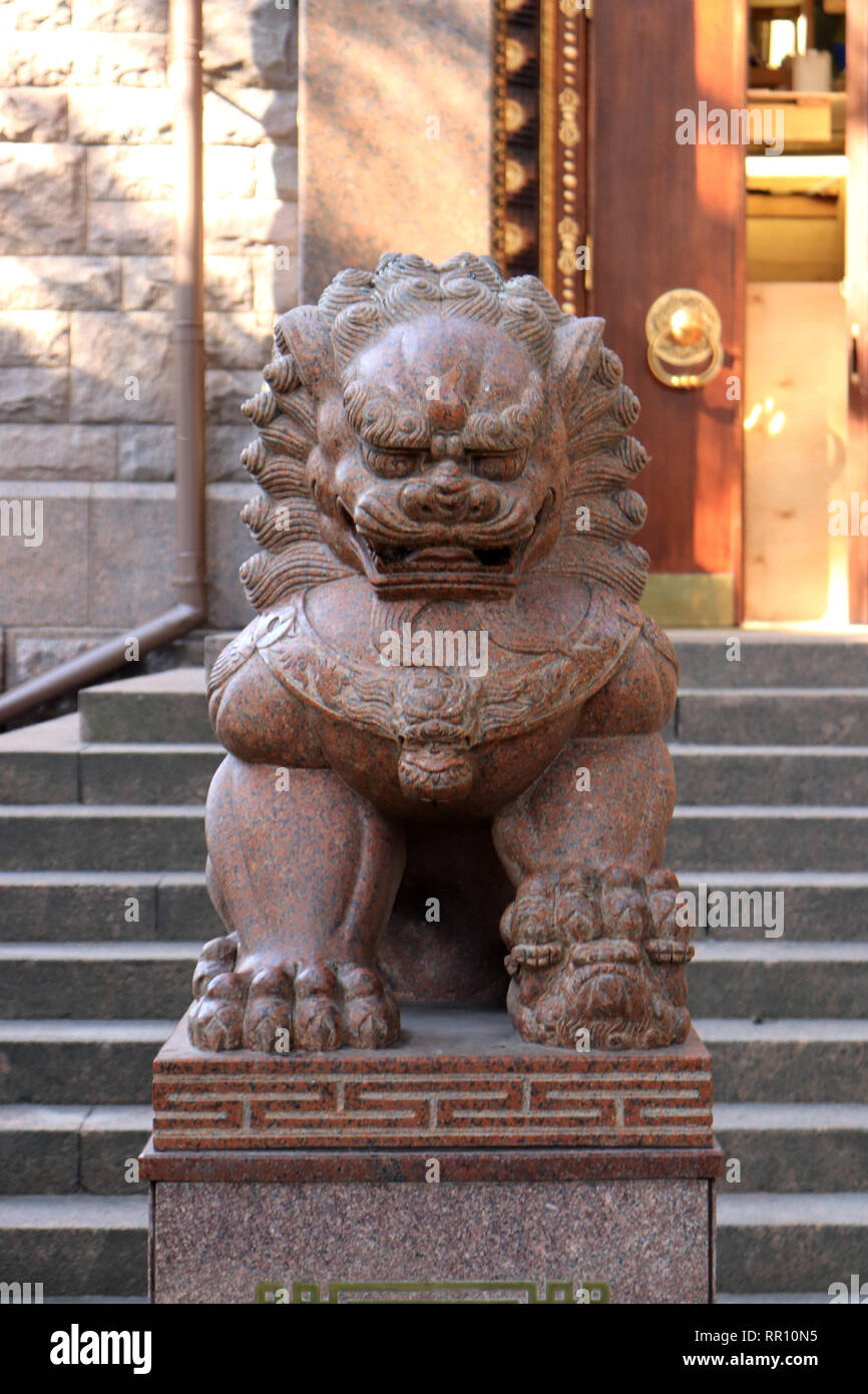 Sculpture of the Far Eastern lion from granite. Buddhist traditional sangha of Russia. Datsan Gunzehoyney. - Stock Image