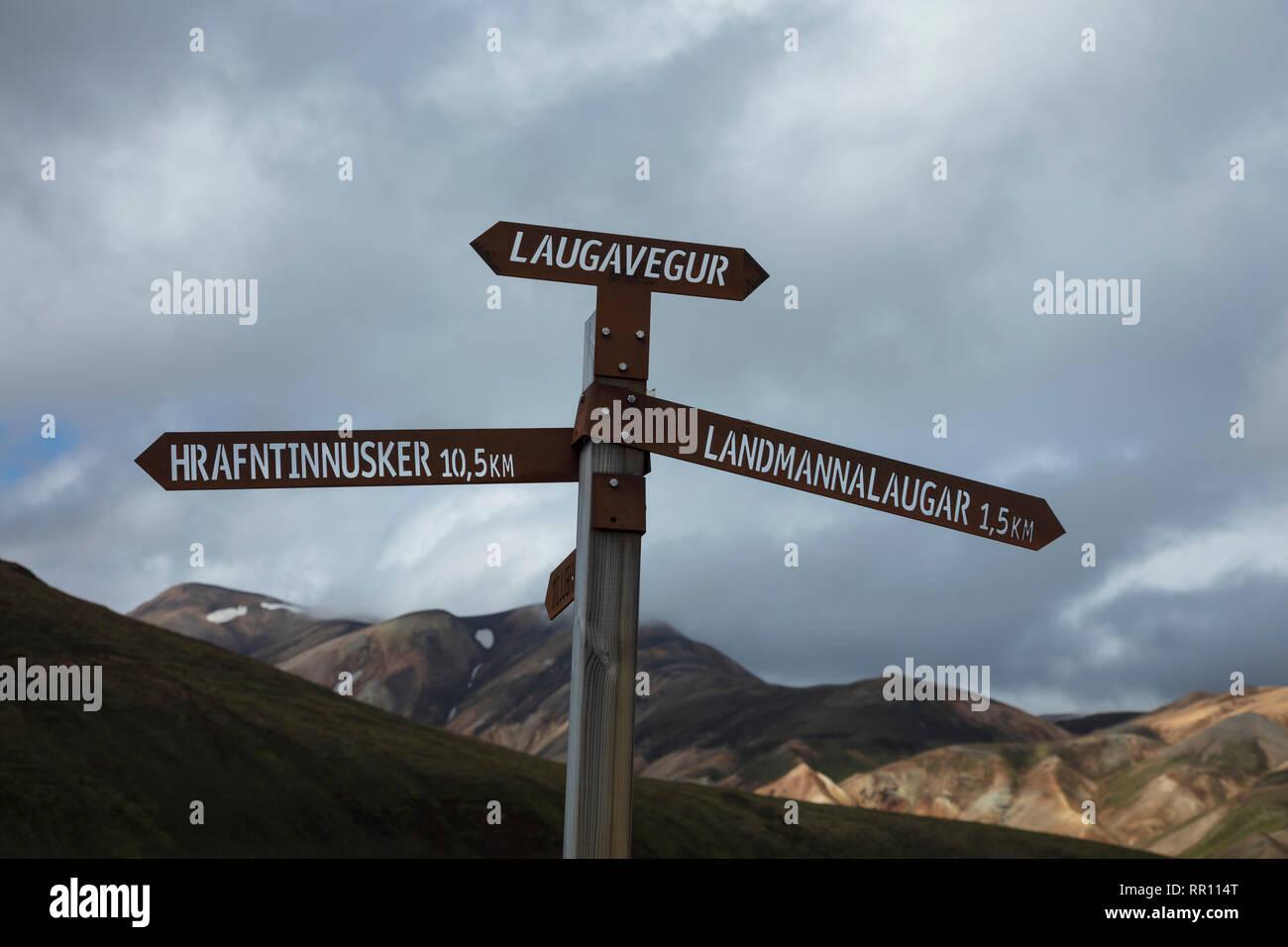 Hiking signpost marking the Laugavegur trail near Landmannalaugar. Central Highlands, Sudhurland, Iceland. - Stock Image