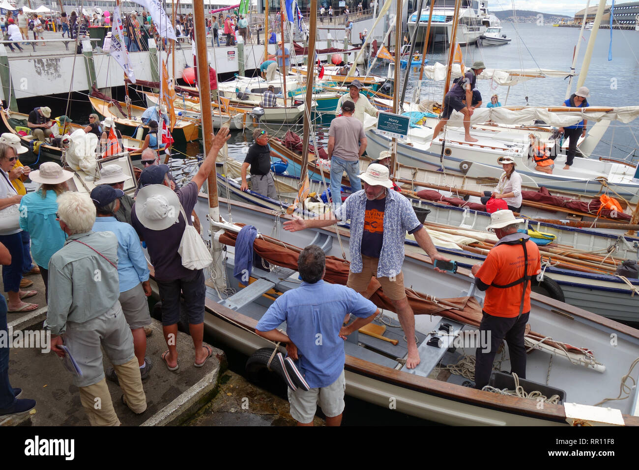 Crews Of Sailing Dinghys And Whaleboats Preparing To Leave The Dock