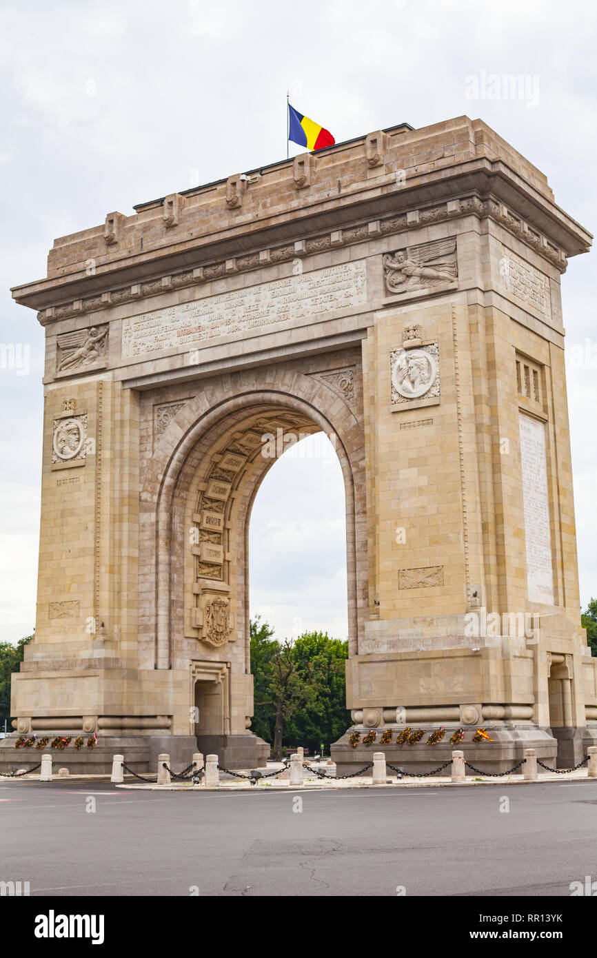 Beautiful picture of the arch of triumph with a romanian flag on it in Bucharest, capital of Romania Stock Photo