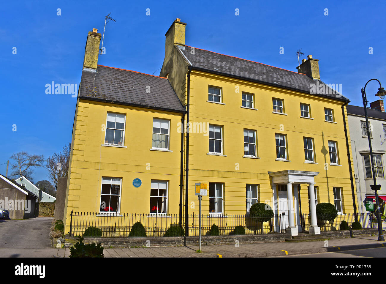 The historic Georgian Woodstock House on the High Street dates from the 18th Century and was the home of the wealthy local Wyndham Family of Dunraven. - Stock Image