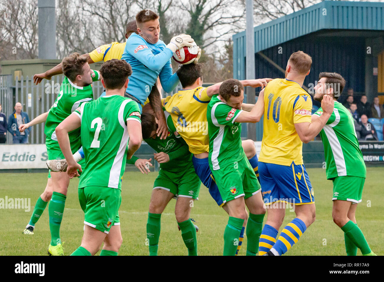 Finnish goalkeeper, William Jaaskelainen, grabs the ball in a goalmouth scrabble when Warrington Town FC host Nantwich Town FC in a football match in  - Stock Image
