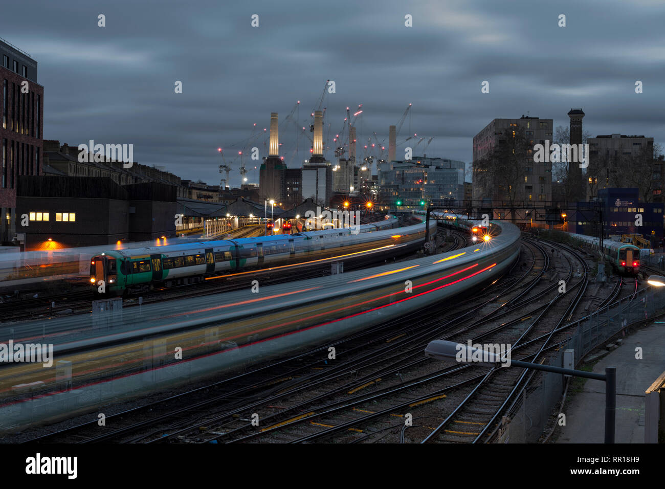 Ebury Bridge, London victoria Battersea power station behind Southern ( GTR ) trains approaching London Victoria station in the London rush hour - Stock Image
