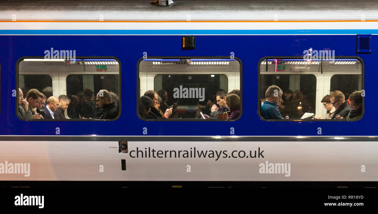 Rail commuters on a busy Chiltern railways train at London Marylebone in the evening rush hour waiting to depart - Stock Image