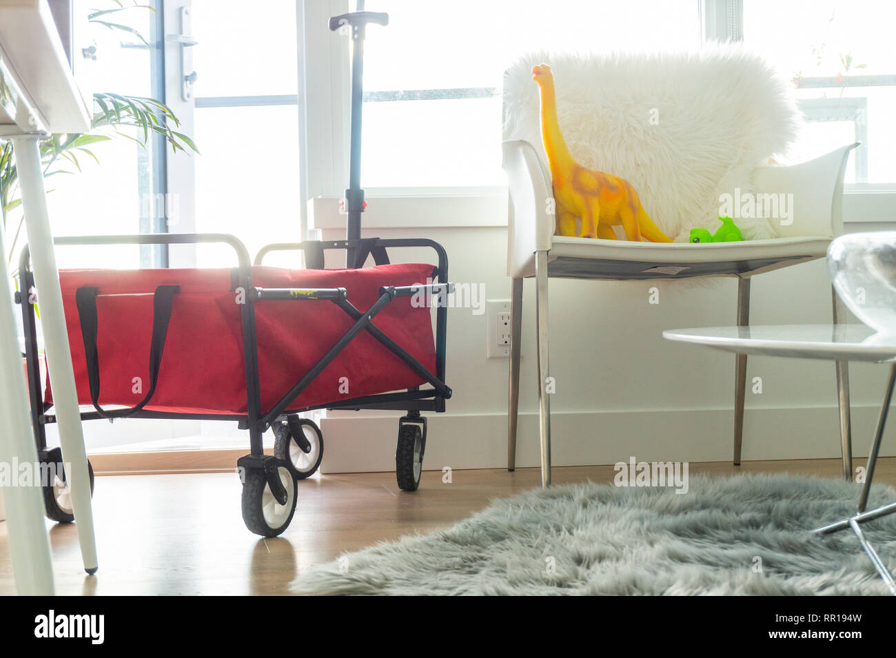 Red Foldable Wagon In Bright Apartment Living Room With