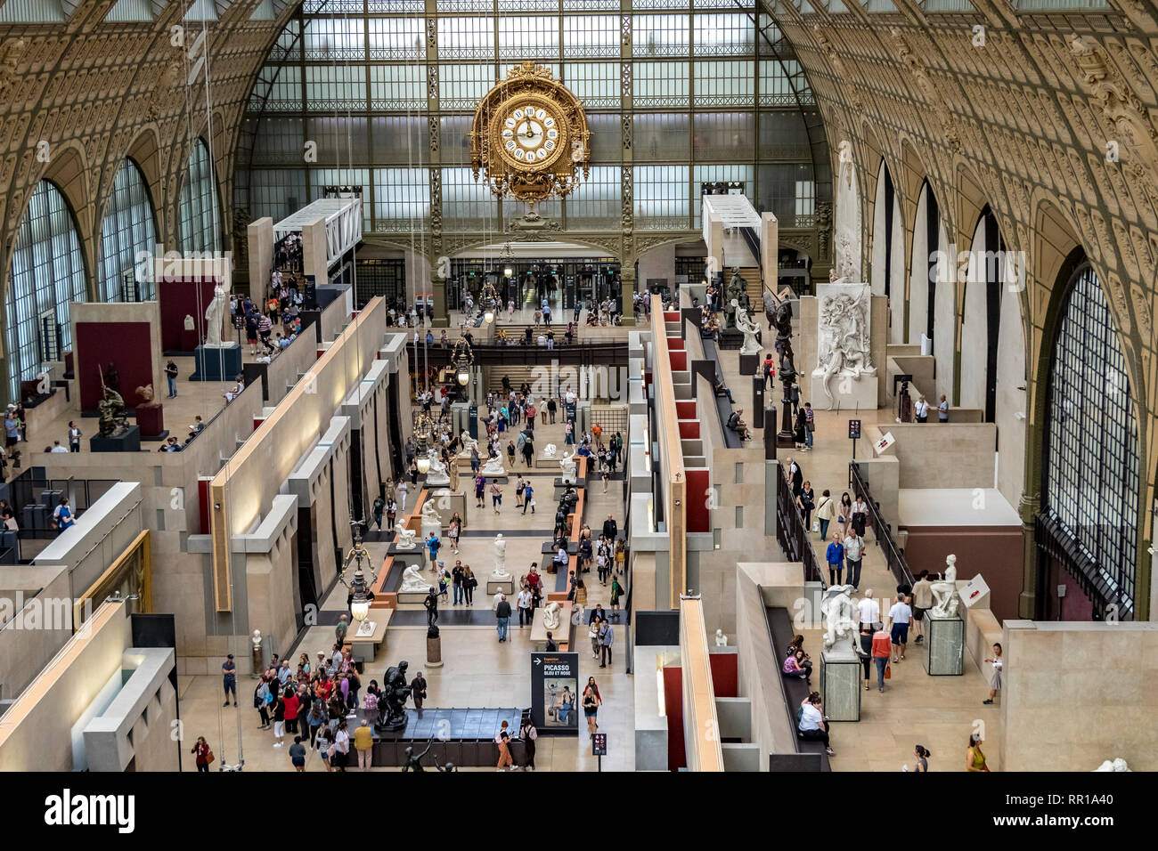Interior of Musée d'Orsay ,the museum building was originally a railway station, Gare d'Orsay, and now houses a world class collection of art ,Paris - Stock Image