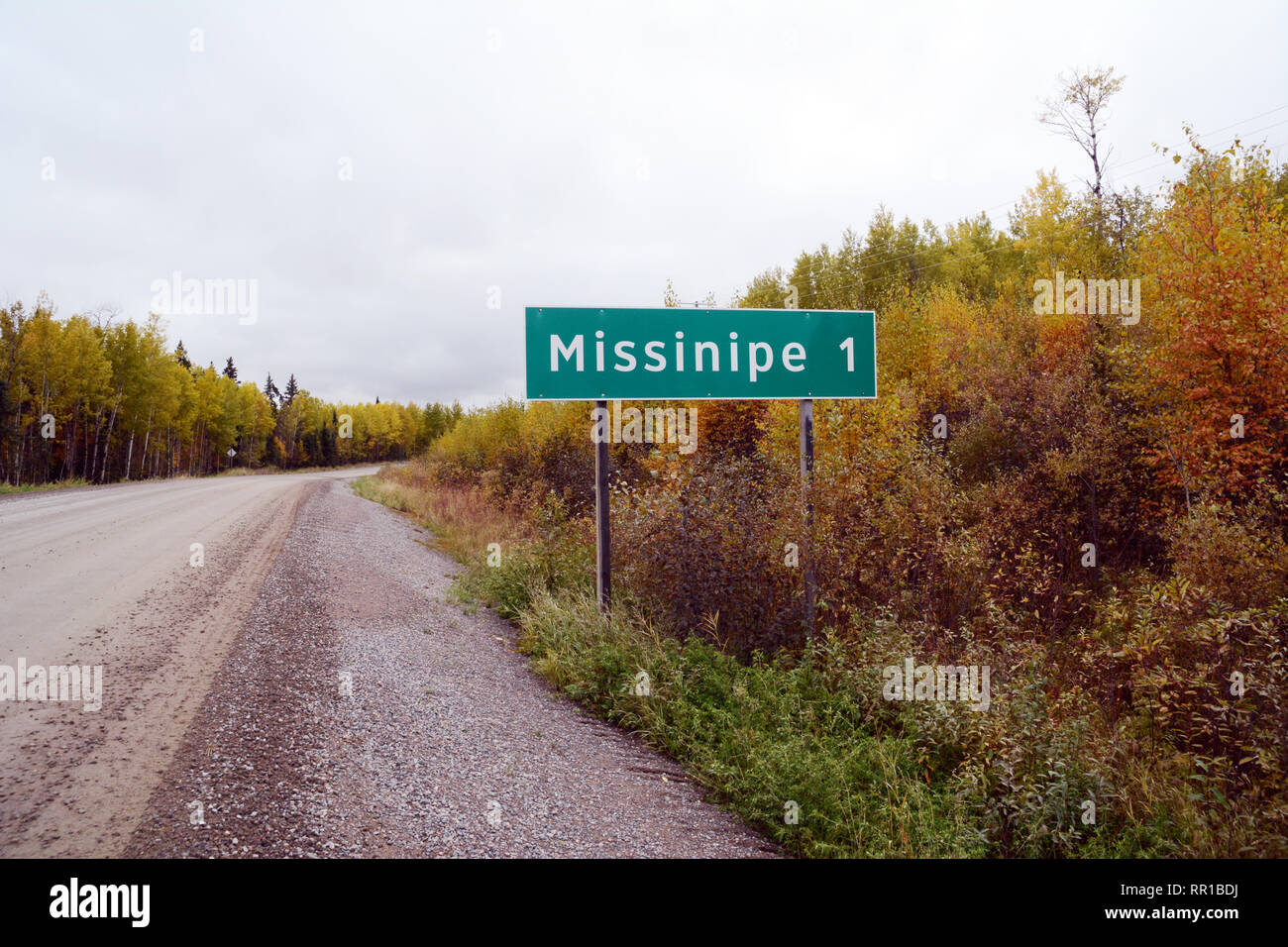 A road sign at the entrance to the town of Missinipe, a remote community in the boreal forest of Northern Saskatchewan, Canada. - Stock Image