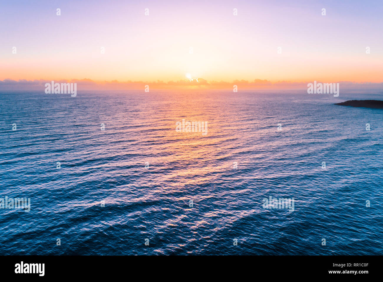 Sunrise over water - beautiful seascape with copy space - Stock Image