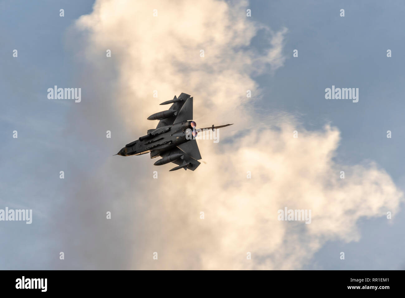 Royal Air Force Panavia Tornado GR4 breaking into the circuit at RAF Marham with full afterburner, reheat. Winter afternoon light. Farewell flypast - Stock Image