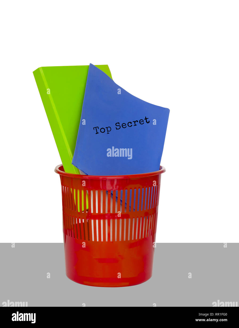 Secret documents and business files in rubbish bin. White background. - Stock Image