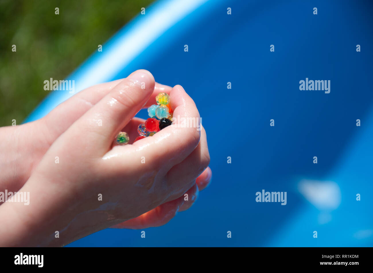 Water beads held in a hand Stock Photo