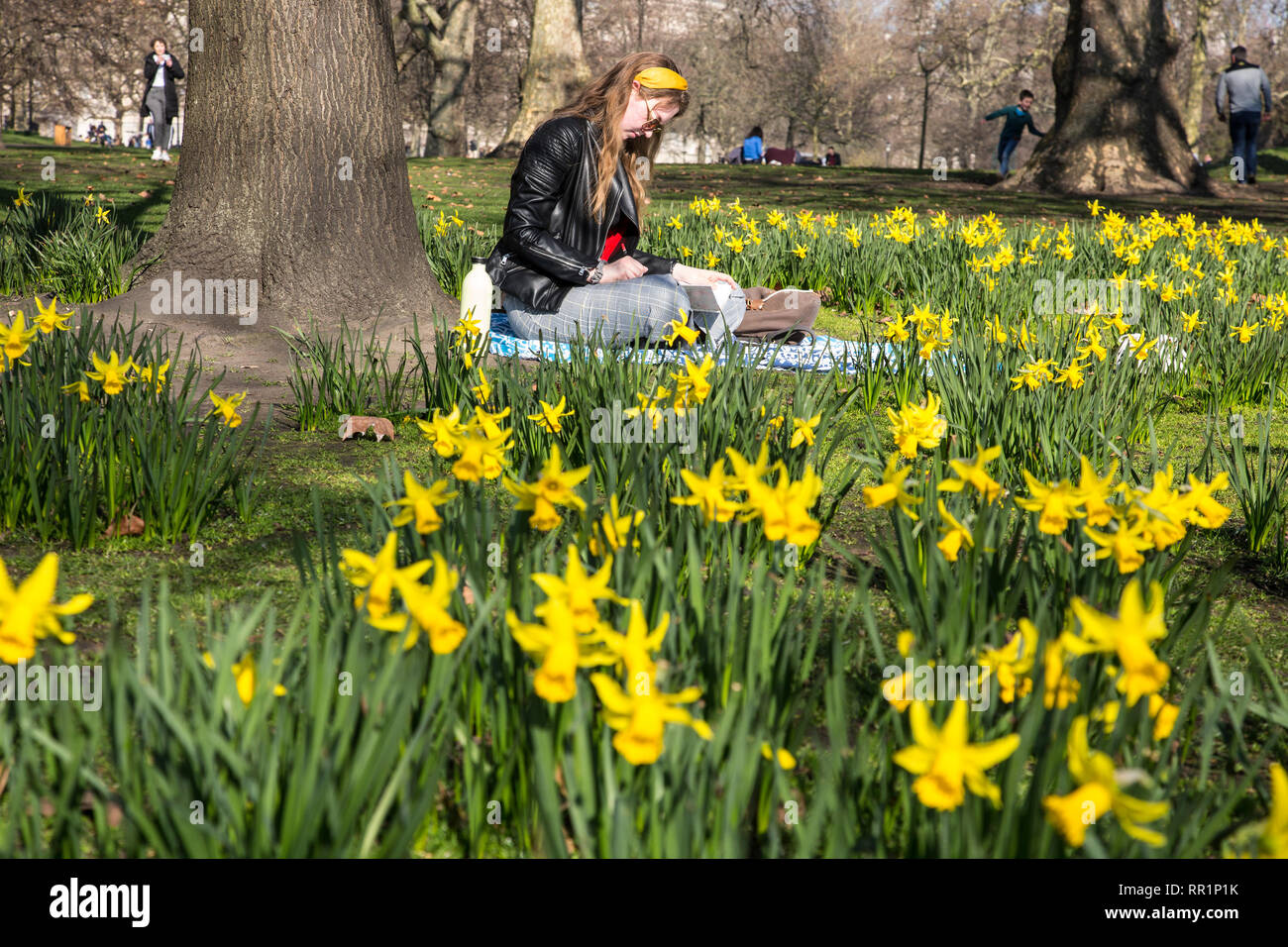 Fenna Harm (19) from germany enjoys the warm temperatures as Spring arrives in St James park, London, England UK 23rd February, 2019 Stock Photo