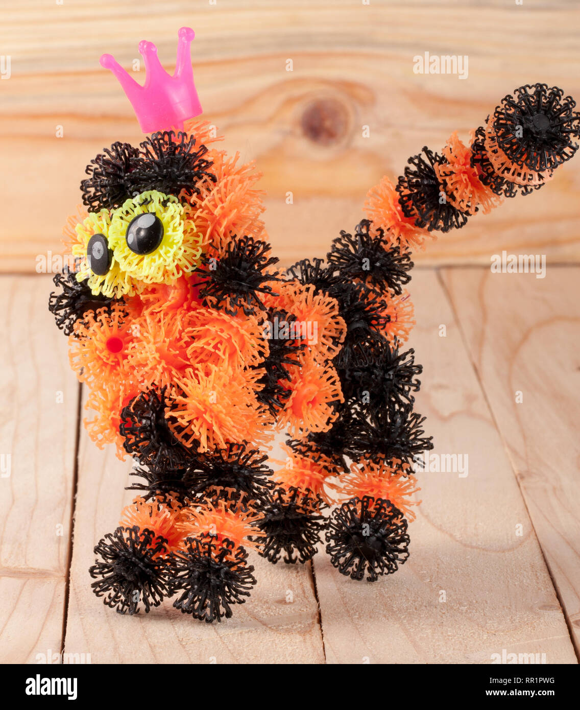 tiger from elements of children's designer of Velcro on a wooden background - Stock Image