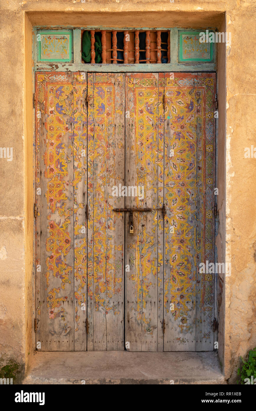 Weathered decorated door, Andalusian Gardens, Casbah, Rabat, Morocco - Stock Image