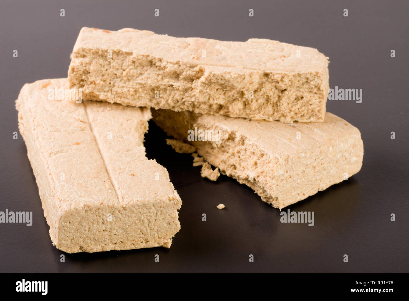 peanut halva on a dark background closeup - Stock Image