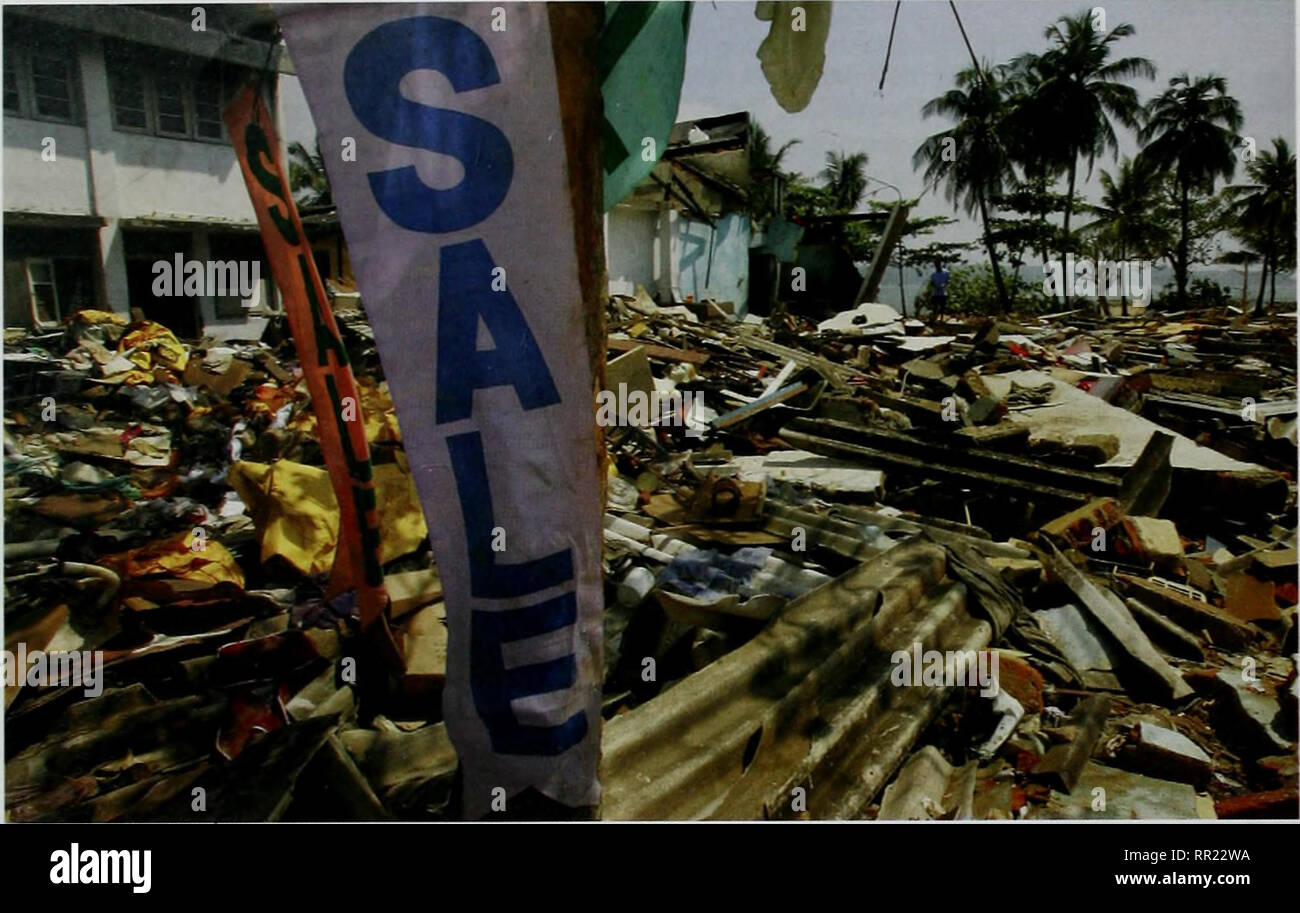 . After the Tsunami: Rapid Environmental Assessment. NATIONAL RAPID ENVIRONMENTAL ASSESSMENT - SRI LANKA. Galle. Sri Lanka (14 January 2005). Debris is seen everywhere in downtown Galle, Sri Lanka, where small shops were reduced to rubble by the 26 Decennber Asian tsunami. © Paula Bronstein/Getty Images bv-passed by the mainstream development process, the poor in particular have found themselves liNdng in informal, illegal and unhealthy conditions, often located in the most ailnerable zones. Such conditions make the poor, and particularly vifomen and children, more vulnerable both to dally st - Stock Image