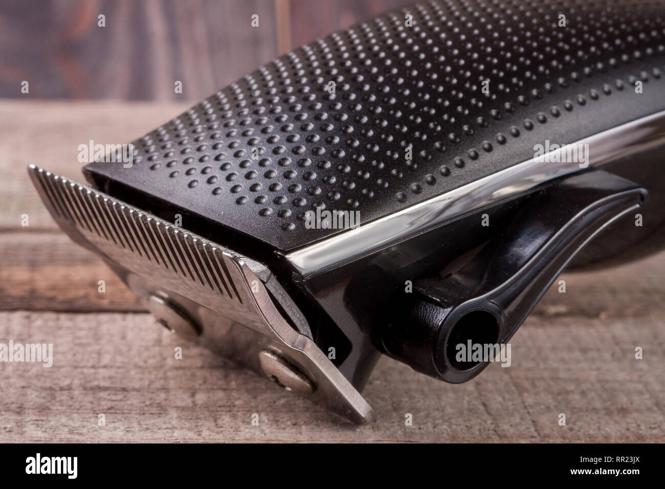 hair trimmer on an old wooden background closeup - Stock Image