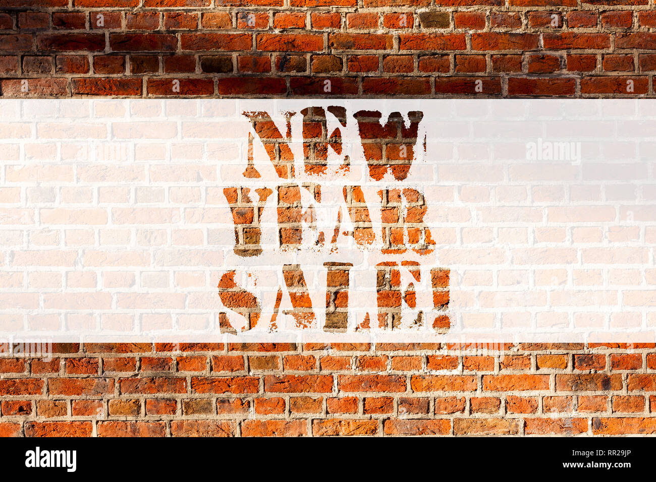 Handwriting text writing New Year Sale. Concept meaning Final holiday season discounts price reductions Offers Brick Wall art like Graffiti motivation Stock Photo