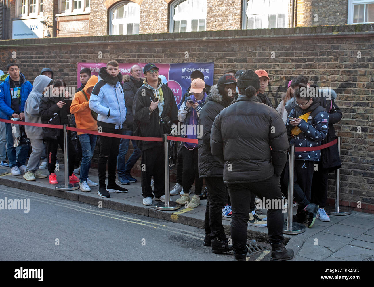 London, UK, 23 February 2019, Hundreds queue at cult skateboard clothing shop Supreme in Peter street in the heart of  Soho as they launch their spring & summer range. Credit: JOHNNY ARMSTEAD/Alamy Live News Stock Photo