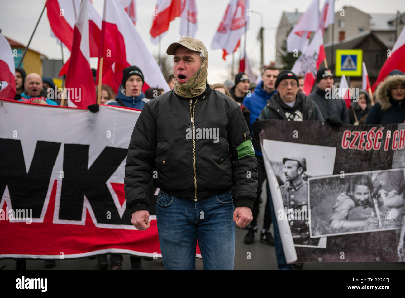 """A nationalist is seen shouting slogans during the march. Polish nationalists organized a commemorative march of the """"Cursed Soldiers"""" in the city of Hajnowka next to the Belarusian border. The Cursed Soldiers also known as the Doomed Soldiers were anti-communist resistant fighters after WWII, however they were also famous of committing crimes against civilians, mostly ethnic Belarusians. - Stock Image"""