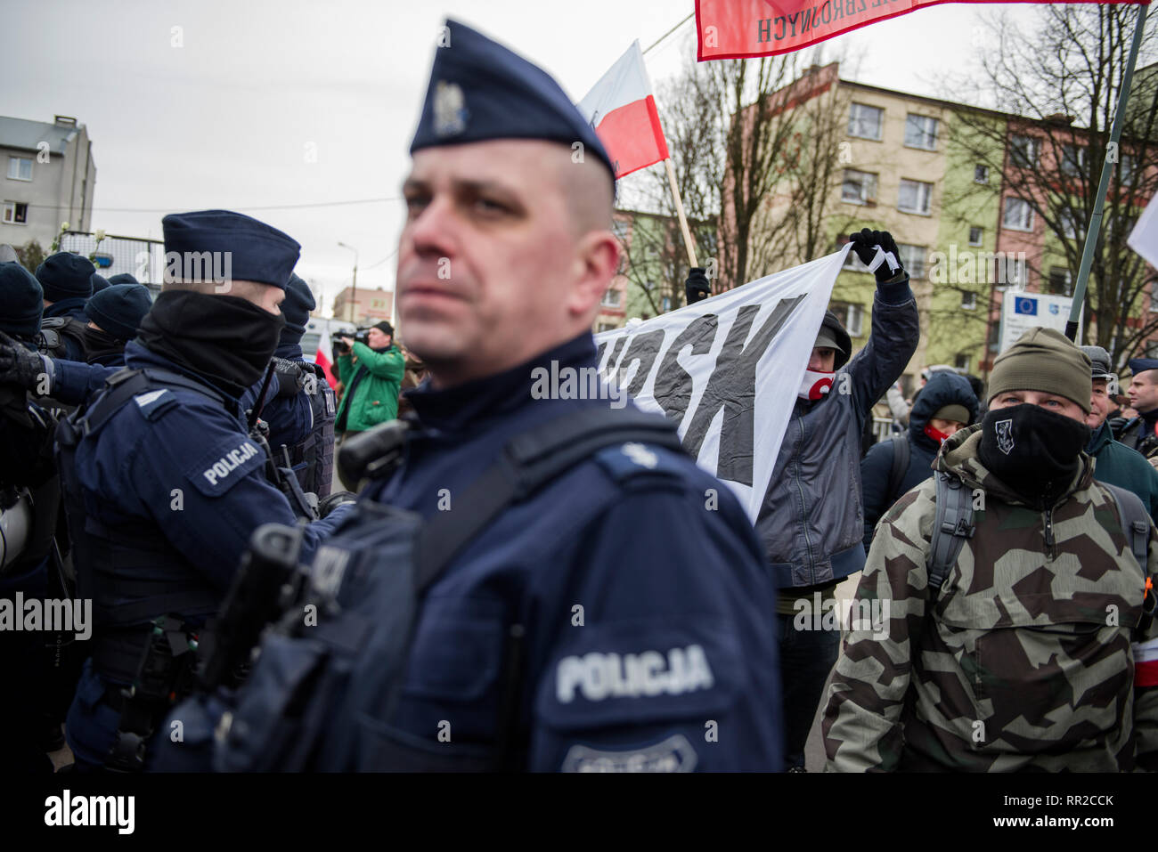"""Police forces seen providing protection during the march. Polish nationalists organized a commemorative march of the """"Cursed Soldiers"""" in the city of Hajnowka next to the Belarusian border. The Cursed Soldiers also known as the Doomed Soldiers were anti-communist resistant fighters after WWII, however they were also famous of committing crimes against civilians, mostly ethnic Belarusians. - Stock Image"""