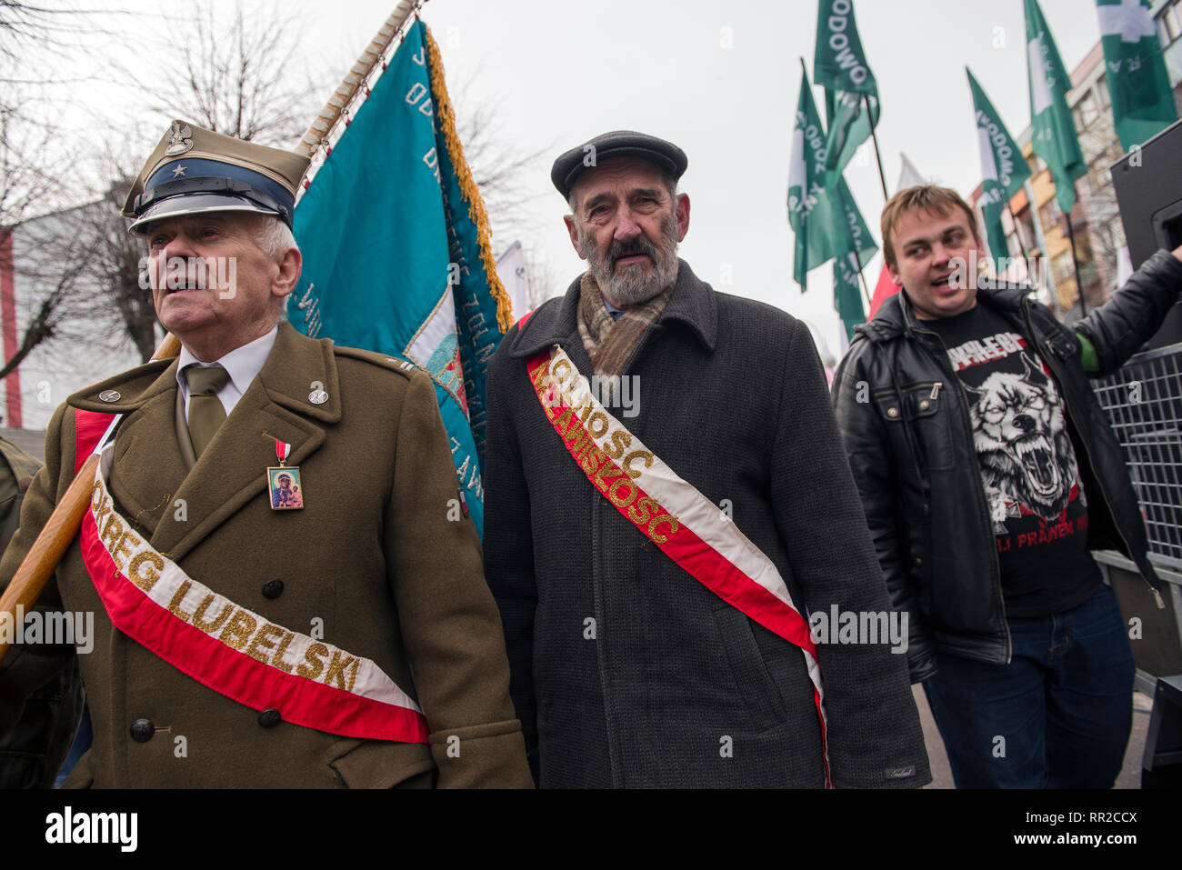 """Nationalists marching to commemorate the Cursed Soldiers. Polish nationalists organized a commemorative march of the """"Cursed Soldiers"""" in the city of Hajnowka next to the Belarusian border. The Cursed Soldiers also known as the Doomed Soldiers were anti-communist resistant fighters after WWII, however they were also famous of committing crimes against civilians, mostly ethnic Belarusians. - Stock Image"""
