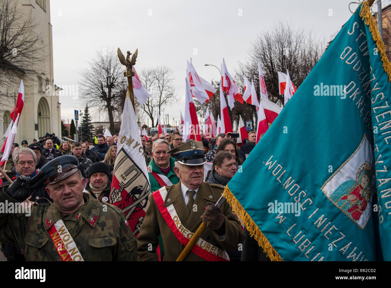"""Nationalists seen singing the Polish anthem during the march. Polish nationalists organized a commemorative march of the """"Cursed Soldiers"""" in the city of Hajnowka next to the Belarusian border. The Cursed Soldiers also known as the Doomed Soldiers were anti-communist resistant fighters after WWII, however they were also famous of committing crimes against civilians, mostly ethnic Belarusians. - Stock Image"""