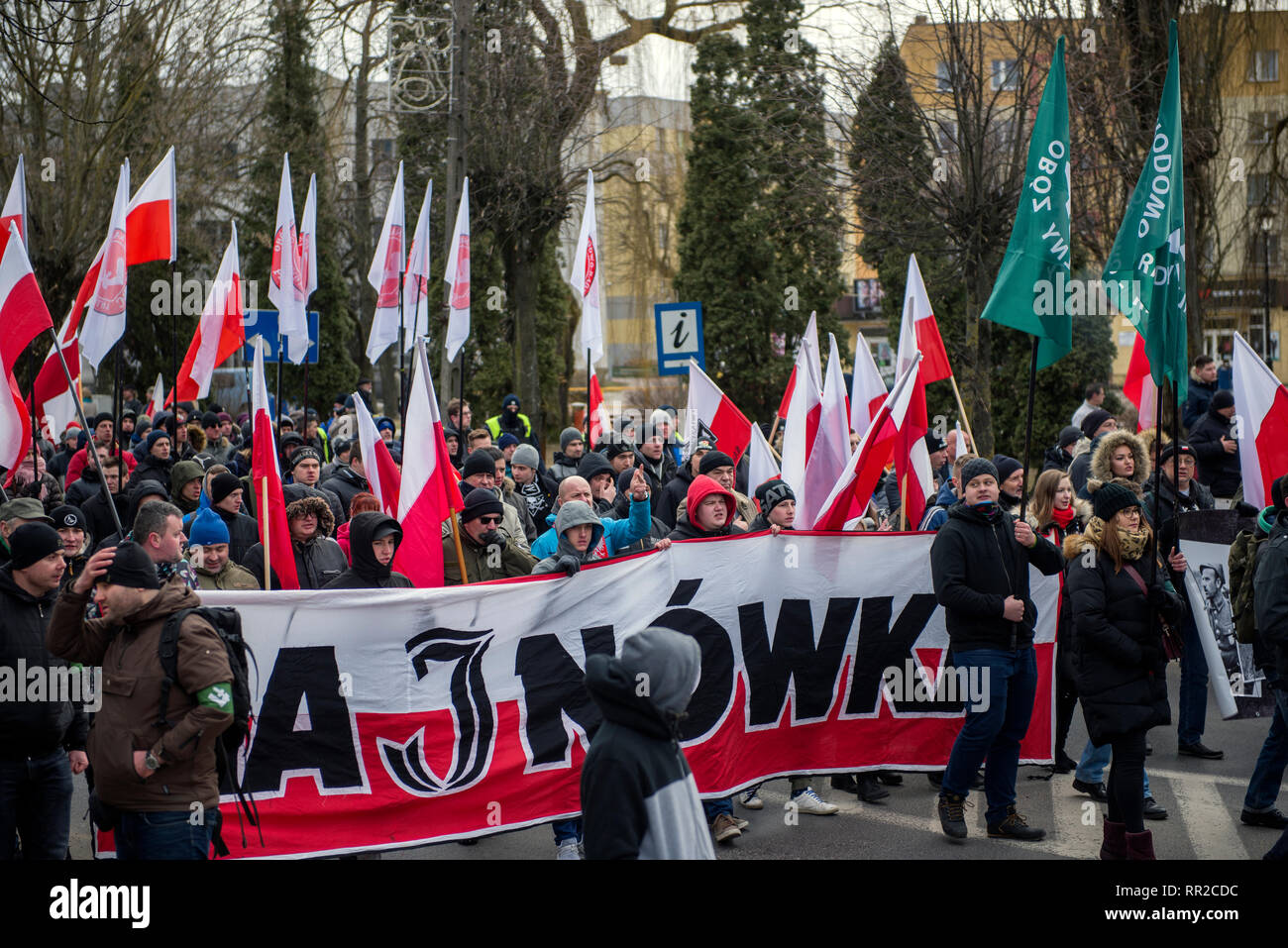 """Polish nationalists seen marching to commemorate the Cursed Soldiers. Polish nationalists organized a commemorative march of the """"Cursed Soldiers"""" in the city of Hajnowka next to the Belarusian border. The Cursed Soldiers also known as the Doomed Soldiers were anti-communist resistant fighters after WWII, however they were also famous of committing crimes against civilians, mostly ethnic Belarusians. - Stock Image"""