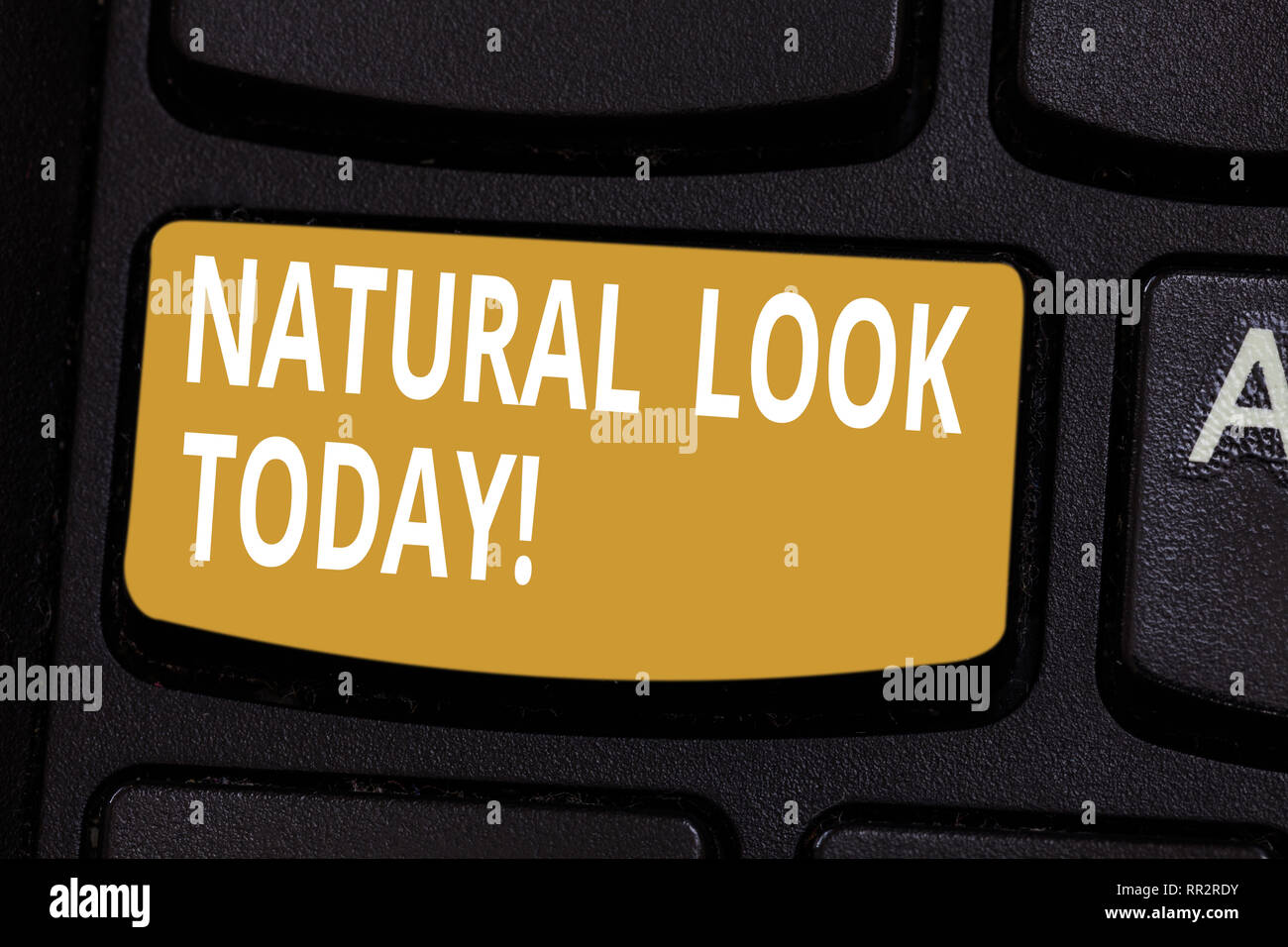 Handwriting text Natural Look Today. Concept meaning not made or caused by showing or chemical substance Keyboard key Intention to create computer mes - Stock Image