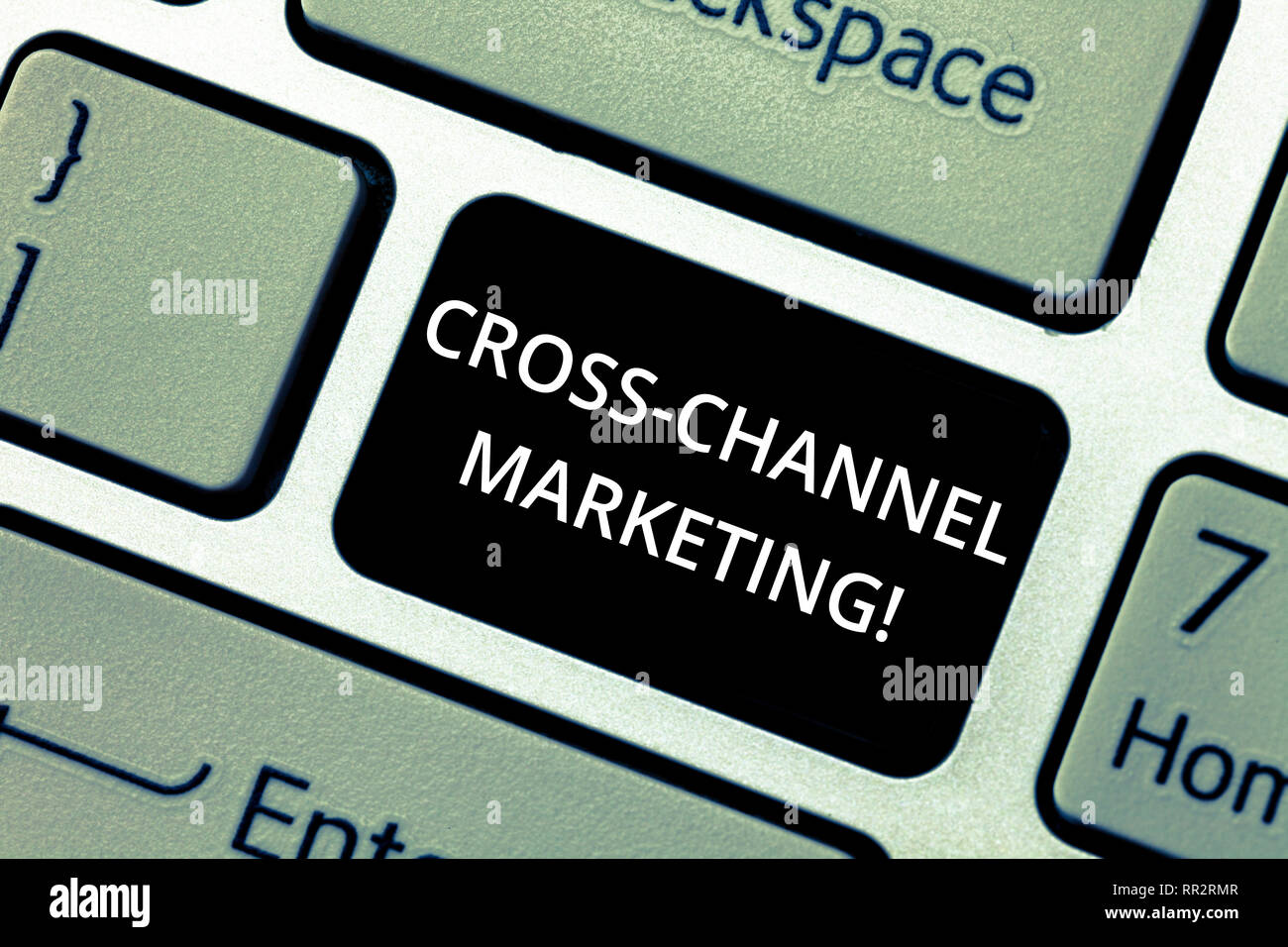 Word writing text Cross Channel Marketing. Business concept for Engaging with customer across every digital channel Keyboard key Intention to create c - Stock Image
