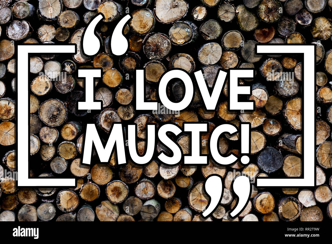 Writing note showing I Love Music. Business photo showcasing Having affection for good sounds lyric singers musicians Wooden background vintage wood w - Stock Image