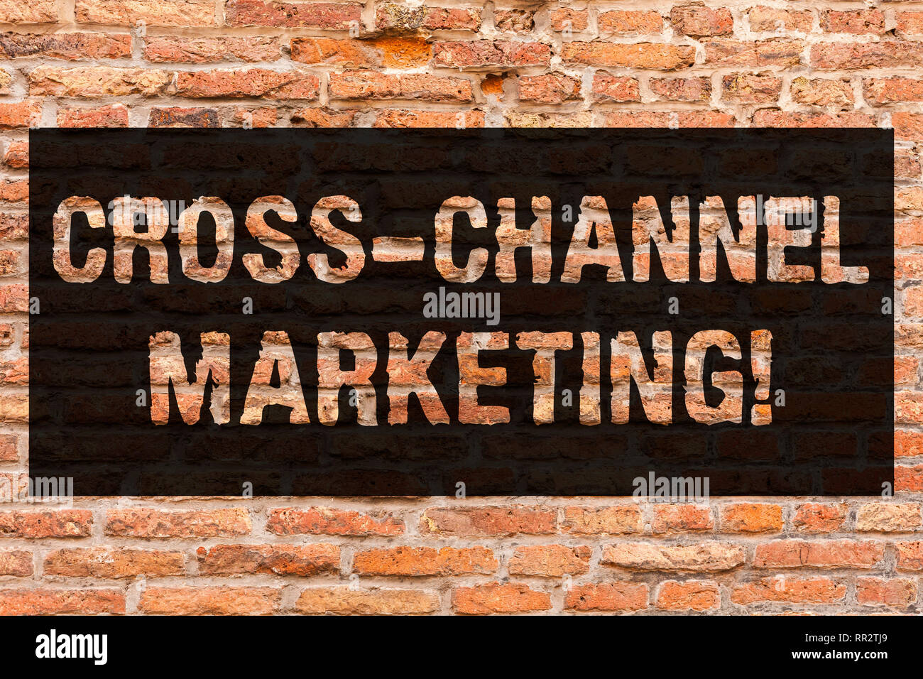 Writing note showing Cross Channel Marketing. Business photo showcasing Engaging with customer across every digital channel Brick Wall art like Graffi - Stock Image