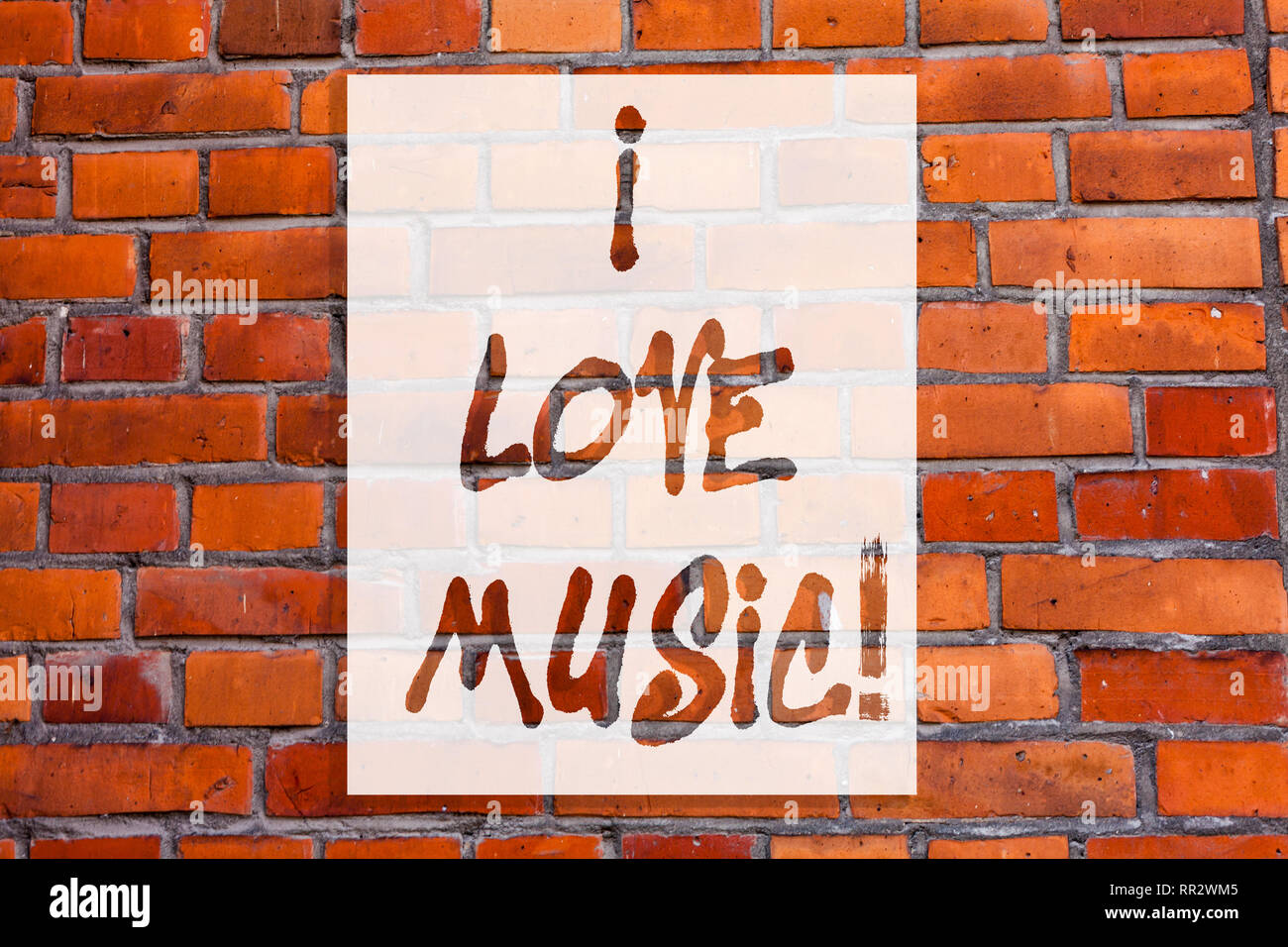 Handwriting text writing I Love Music. Concept meaning Having affection for good sounds lyric singers musicians Brick Wall art like Graffiti motivatio - Stock Image