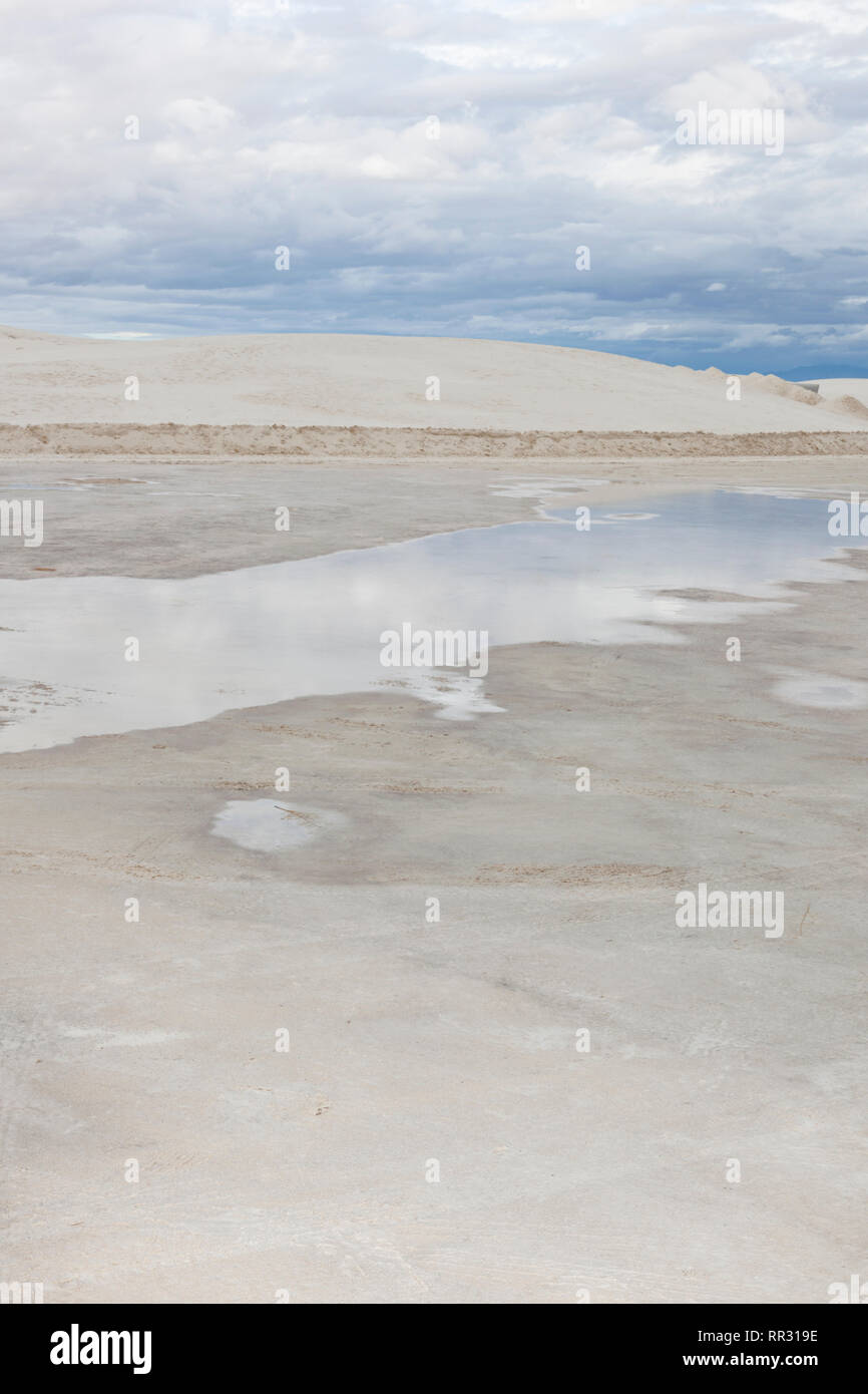 Rain stands in puddles at White Sands National Monument - Stock Image