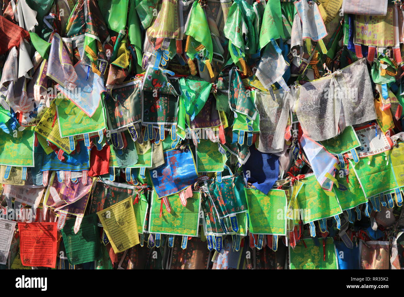 A lot of cloth shawls. The guessing of desire. Prayer. Worship. Buddhist traditional sangha of Russia. Datsan Gunzehoyney. - Stock Image