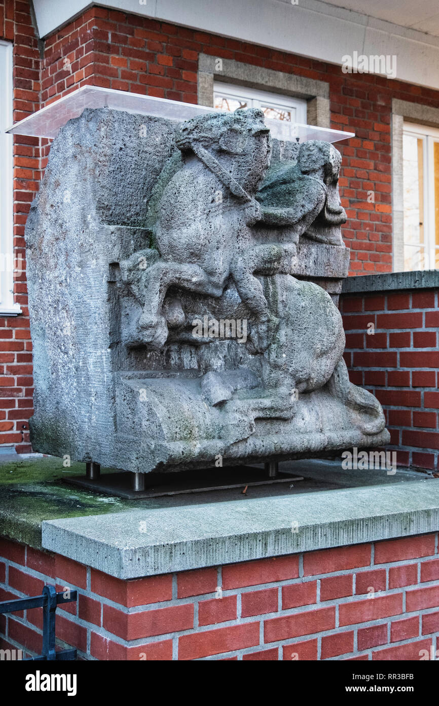 Weathered old equestrian sculpture outside Springer Nature academic publishing company building, 3 Heidelberger Platz, Wilmersdorf-Berlin - Stock Image