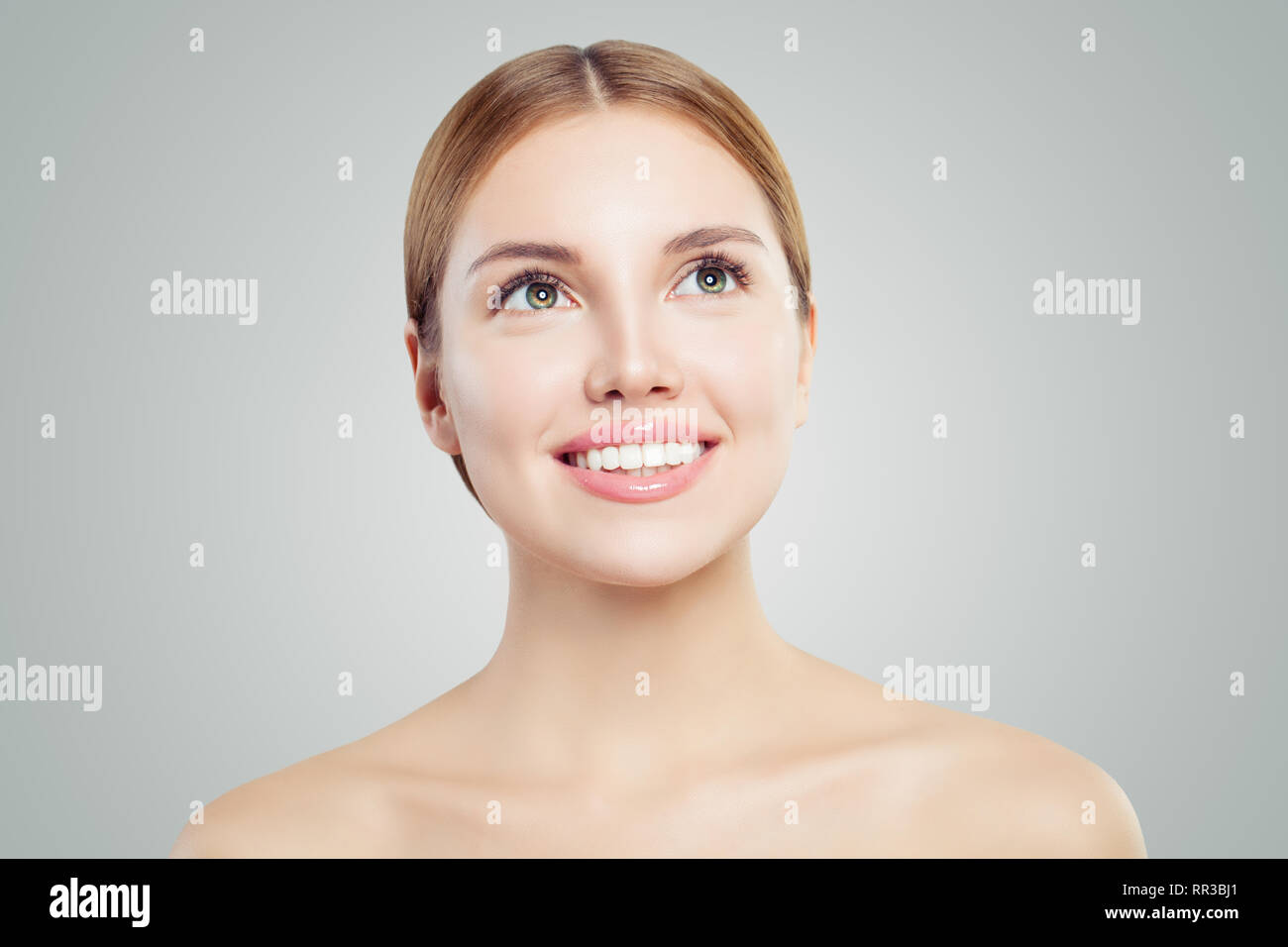 Young Perfect Woman Looking Up Closeup Portrait On White Background