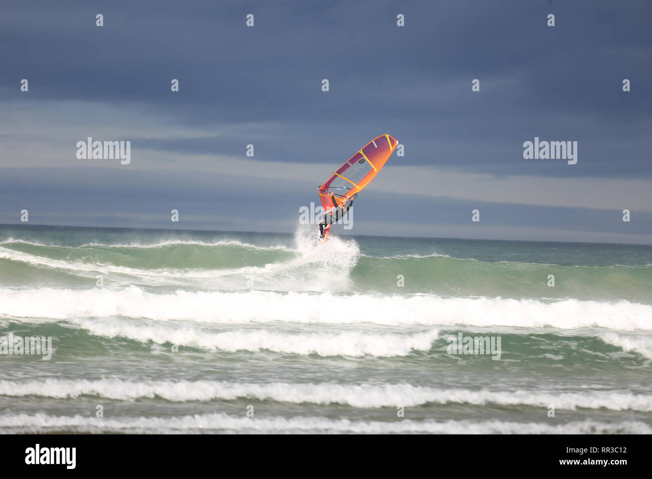 wind surfers enjoying the wild atlantic way sea storms, county kerry, ireland - Stock Image