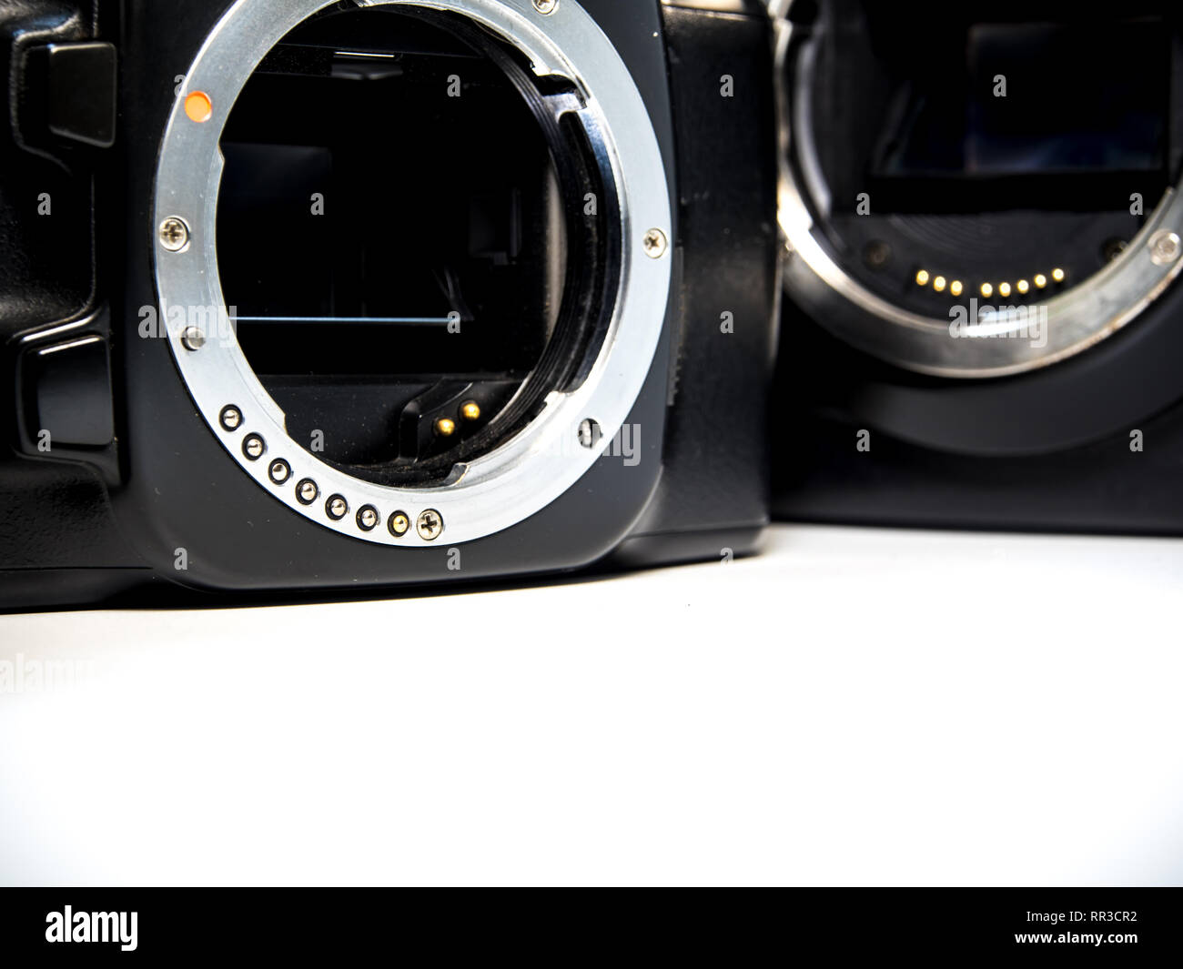 Front view of SLR camera body metal bayonet lens mount PK and CA without lens - Stock Image