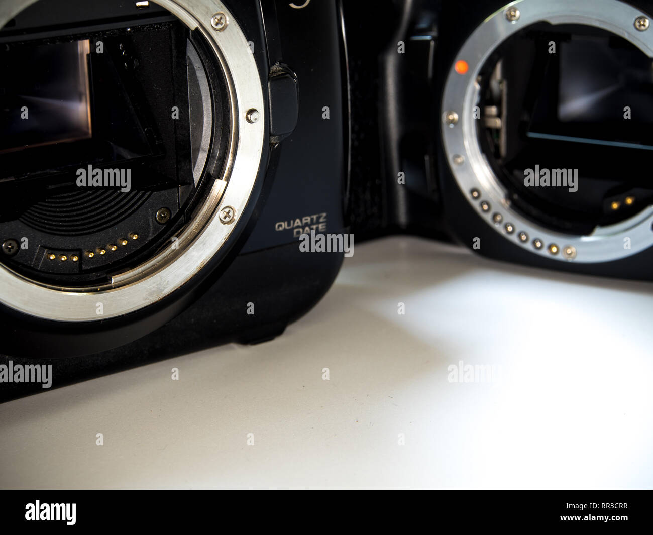 Front view of SLR camera body metal bayonet lens mount C and PK without lens - Stock Image
