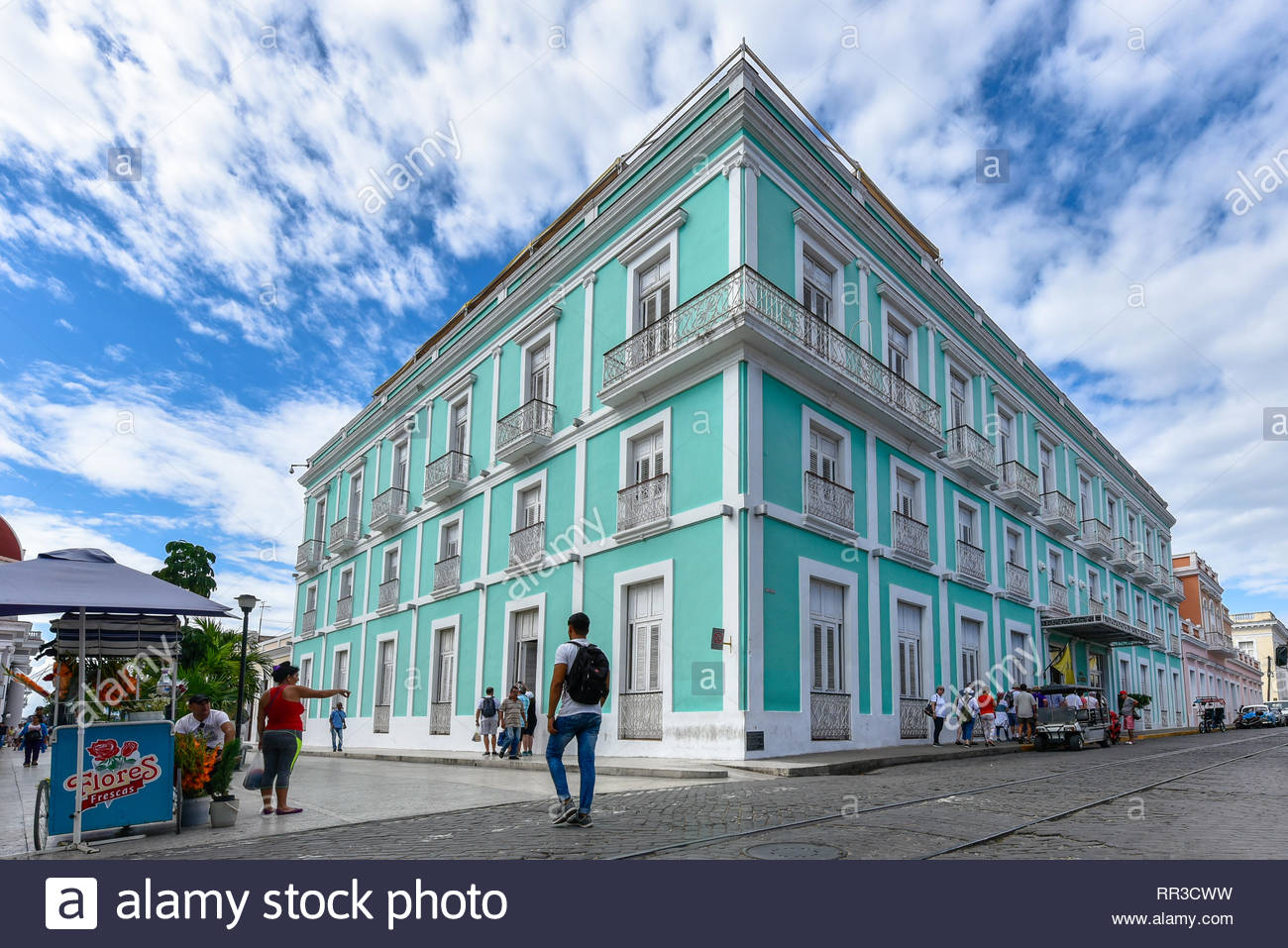 Hotel 'La Union' operated by Melia Hotels. The colonial building is painted in pastel green contrasting with the blue sky. Wide angle view of the land - Stock Image